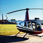 R44 Helicopter.  3 passenger seats plus the pilot.  Every passenger is guaranteed a window seat.