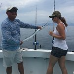 Captain Pete made sure this combat veteran got to catch and kiss a fish.