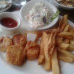 Sea scallops fries cole slaw and melt in your mouth hushpuppies