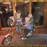 kids enjoying on SYD's bike. hehe