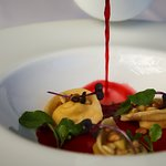 Goats' curd & raisin tortellini, with beetroot consomme