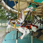 Two horses named Bag Pipe and Warhorse on the carousel at Krape Park in Freeport.