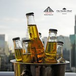 Get boozed up after work and enjoy a bucket of beer at Encima Roofdeck Restaurant.