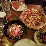 Pizza, salad and olives with drinks