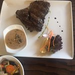 Steak medium rare with mushroom sauce, cooked to perfection