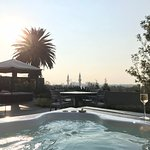 Enjoying champagne in the hot tub with the city view