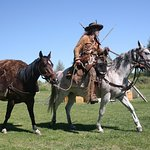 American Mountain Man Todd Schulz demonstrates a fur trapper's mount and pack horse.
