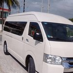 One our vans, roomy, comfortable, clean and waiting for you!