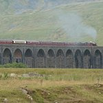 Steam train crossing the viaduct