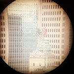 View of the Magnolia Building through one of the free telescopes