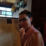 My daughter enjoying reading the menu