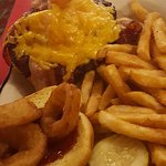 Reuben sandwich. Bacon cheeseburger with fries. Cool beer
