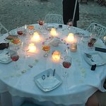 The staff were very attentive when we had dinner on the beach, even when he threat of a shower c