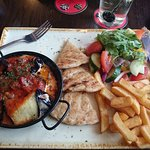 Aubergine rolls with chips and pitta bread