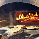 Pizza bases, baked hot and crisp in our wood-fired oven