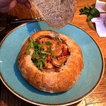 Peanut and Prawn Maracana, a Brazilian curry served in a large hollowed out sourdough loaf