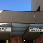 The entrances use signage common in Apartheid times