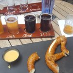 beer flights accompanied by a Pretzel