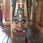 /decorated timber support column in a traditional hut, part of the outdoor exhibits