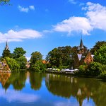 A view along the Minnewater (Lake of Love) with the Kasteel Minnewater Restaurant featured on th