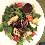 Fresh grilled veggies on top of leafy green salad with Smoked Balsamic dressing!
