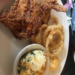 Fried chicken, onion rings, squash casserole and cheese biscuit