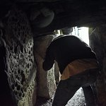 Exiting the first interior doorway in Cairn T at Loughcrew.