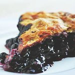 Maine blueberries and a buttery crust, usually served warm with a touch of vanilla ice cream.