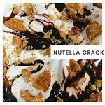 Cheesecake ice cream loaded with nutella swirls and pralined crackers!