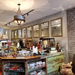 A welcoming coffee bar featuring flavor options. Great assortment of grab and go snacks!