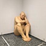 Giant naked baby man