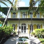A view of the front of the Ernest Hemingway Home and Museum in Key West