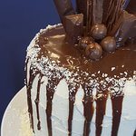 Vanilla and Chocolate layered Sponge covered with Buttercream drizzled with Chocolate