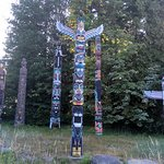 Totem poles with history and individual plaques