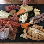 Charcuterie -Chef's selection of artisanal meats and cheeses, sourdough, pickled vegetables, mus