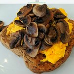 Scrambled eggs with mushrooms on granary toast
