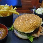 Lamb burger with french fries and a homemade sauce
