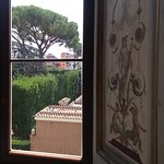 Looking out a window in the Villa Farnesina in Rome
