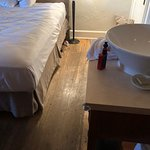Sink is located directly next to bed, causing potential danger for small children.