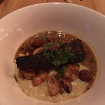 Frogmore, shrimp, bass, creamed corn and italian sausage gravy