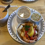 Baked seafood, rice pilaf, Cole slaw and lobster bisque.