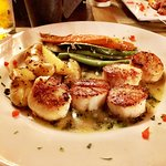 Scallops with potatoes and vegetables