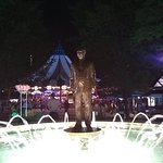 Milton Hershey statue at night