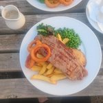 Delicious locally sourced steak with homemade peppercorn sauce and chips.
