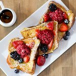 French toasted brioche bread  served with berry butter, syrup  and powdered sugar