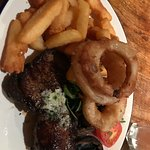 Steak with portobello mushrooms, onion rings and chips