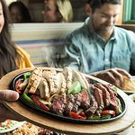 Our famous fajitas are grilled over mesquite wood and served with warm flour tortillas, sour cre