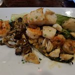 Seafood scampi over grilled romaine