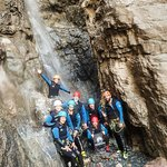 Our group at the bottom of the 60ft waterfall rappel. :D