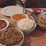 Butter chicken, naan, breyani and chicken tikka curry